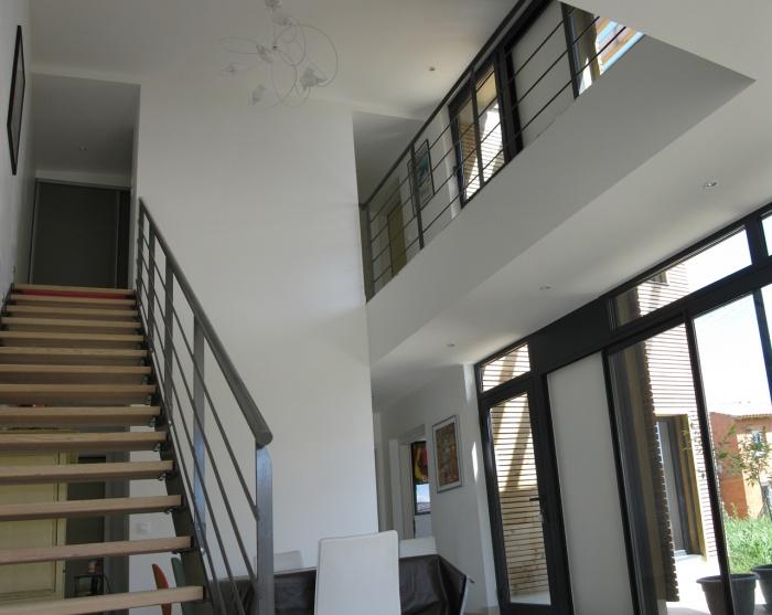 Maison bioclimatique t.h.p.e. : Double hauteur